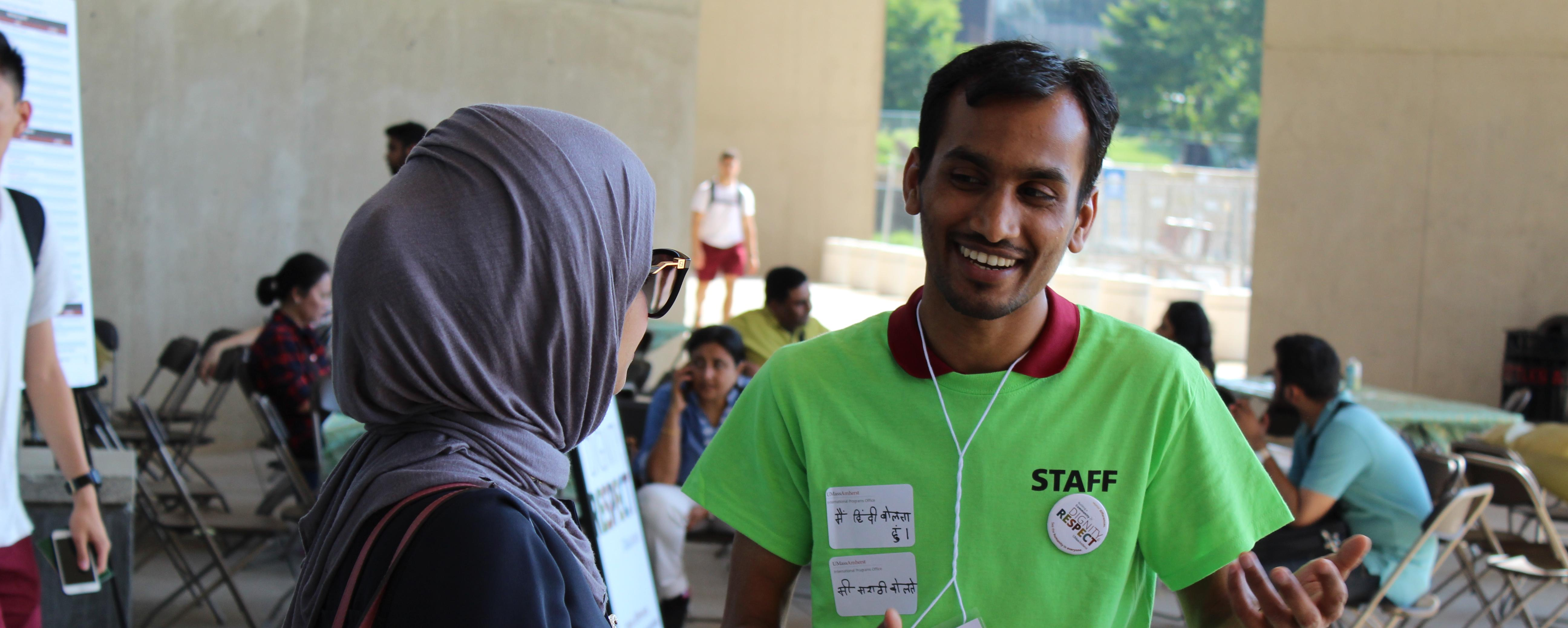 A student volunteer helps at New Student Orientation