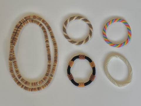 beaded crocheted jewelry, four bracelets, two necklaces