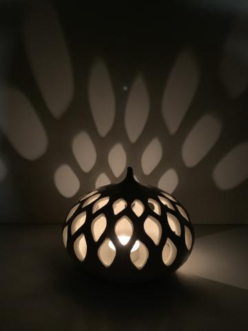 Light shining through tear shapped pottery