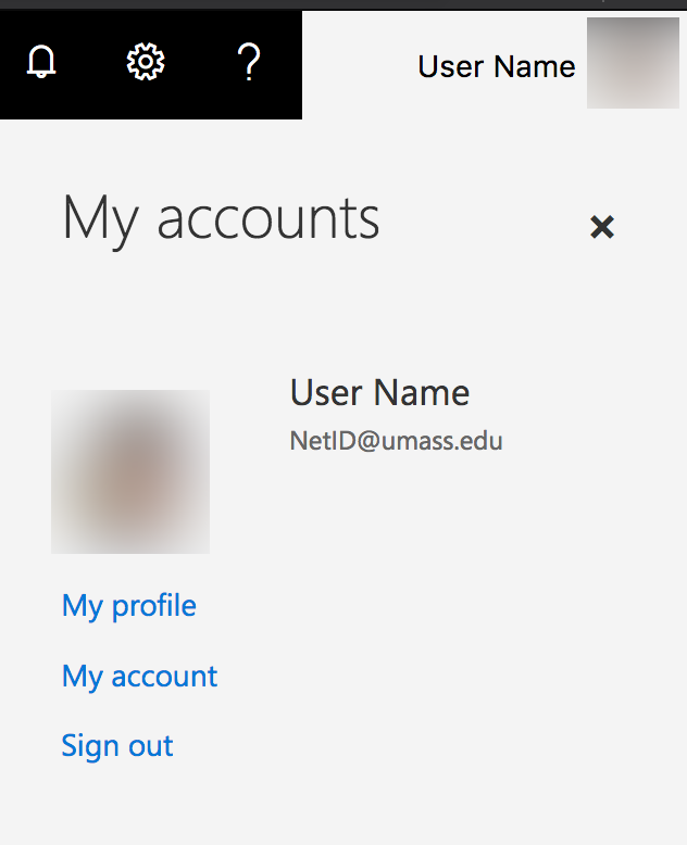 OneDrive web interface showing the location of the Sign Out button - in the menu to the upper right