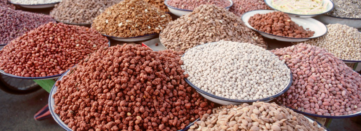 A variety of grains and pulses displayed at a market