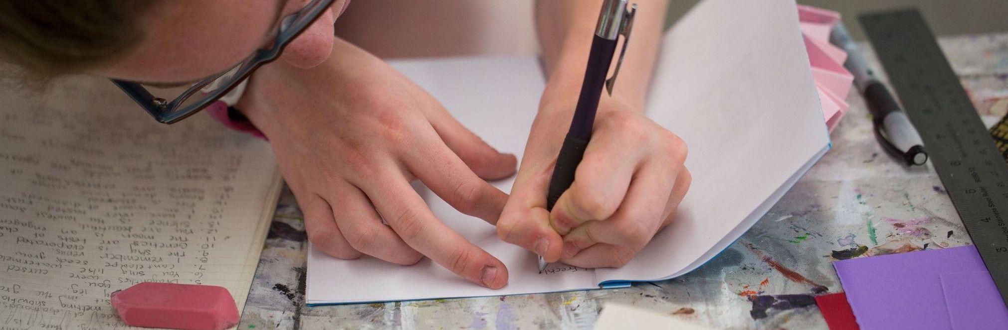 juniper participant writes in a notebook