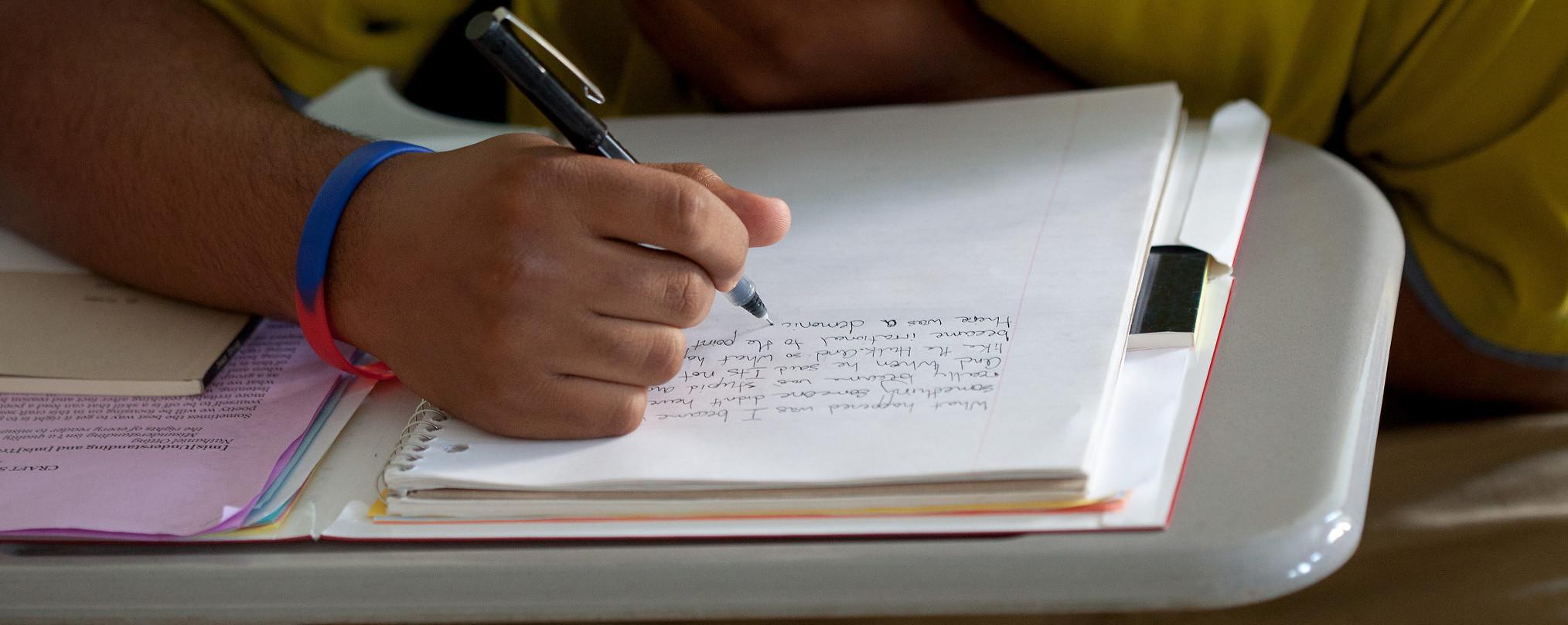 A juniper participant writers in a notebook
