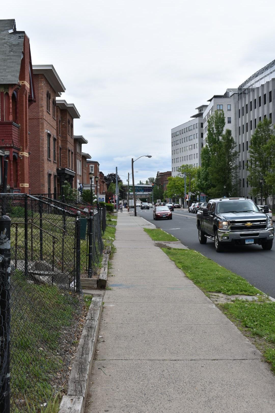 sidewalk between community and the hospital