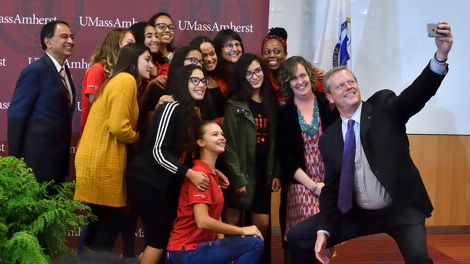 Governor Charlie Baker takes a selfie with UMass Amherst student and Chancellor Kumble R. Subbaswamy