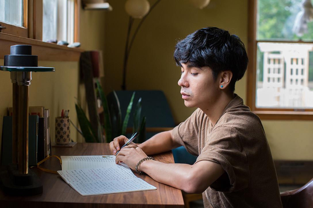 Ocean Vuong at desk