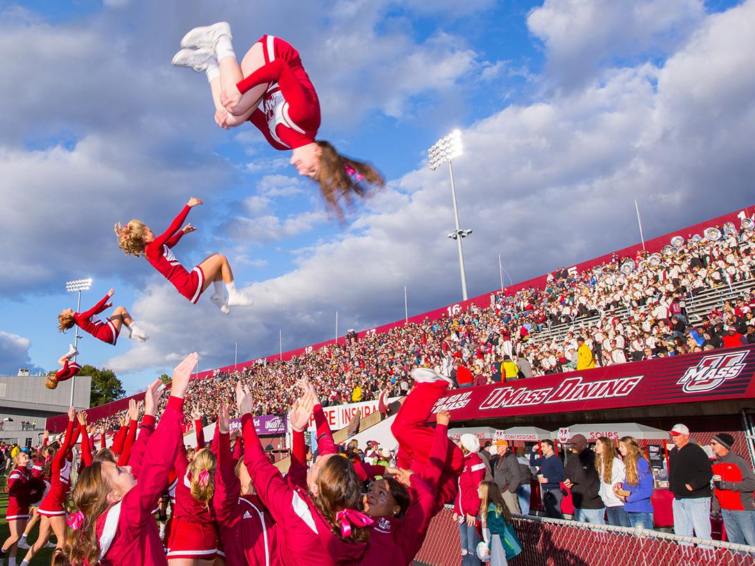 Cheerleaders jumping in air