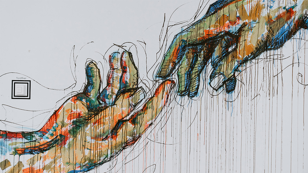 Mural of hands touching fingers.