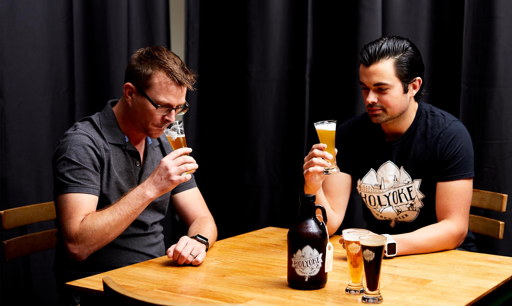 Brewery owners tasting beer