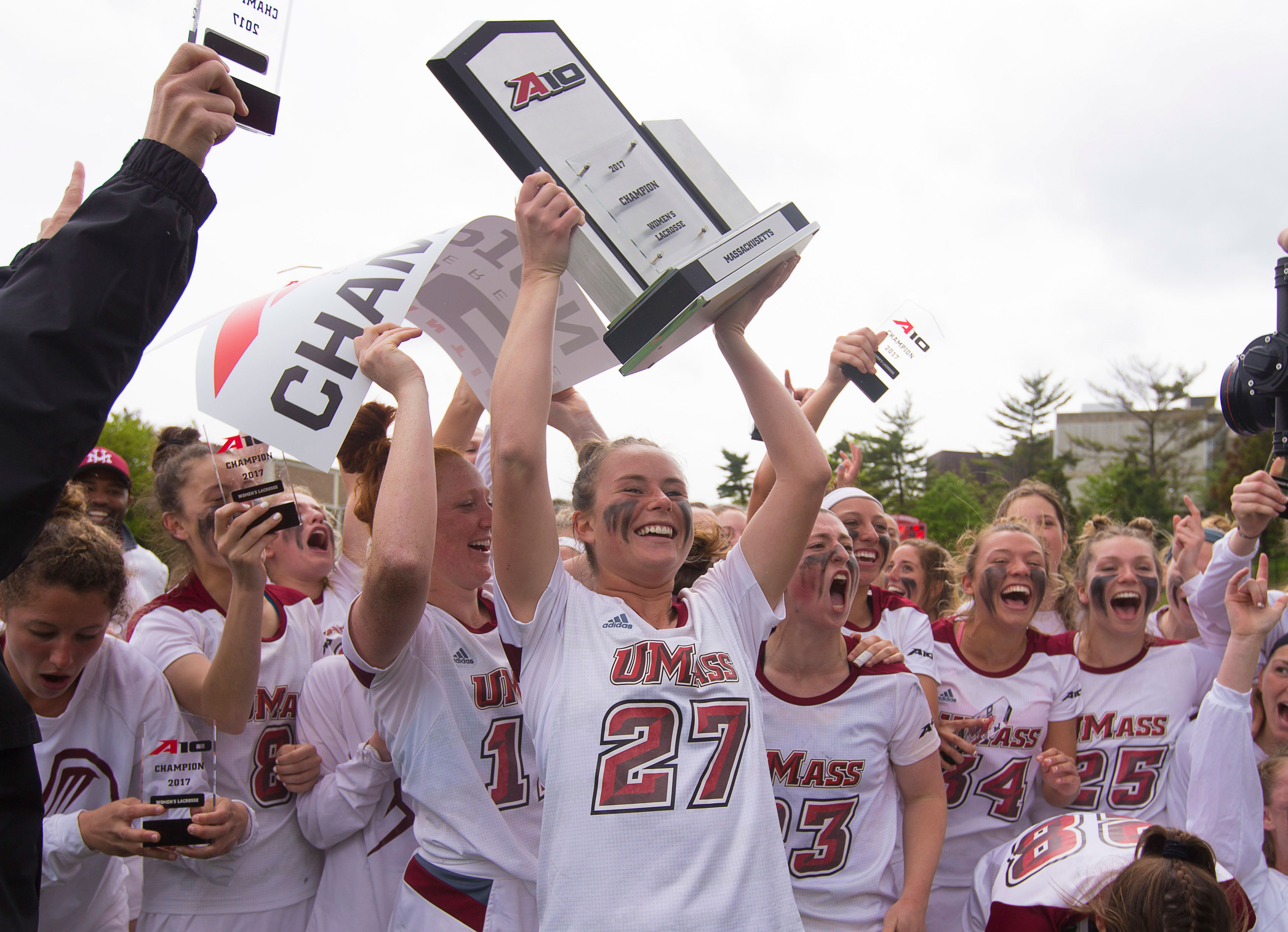 The UMass women's lacrosse team celebrates after their Atlantic 10 championship win.