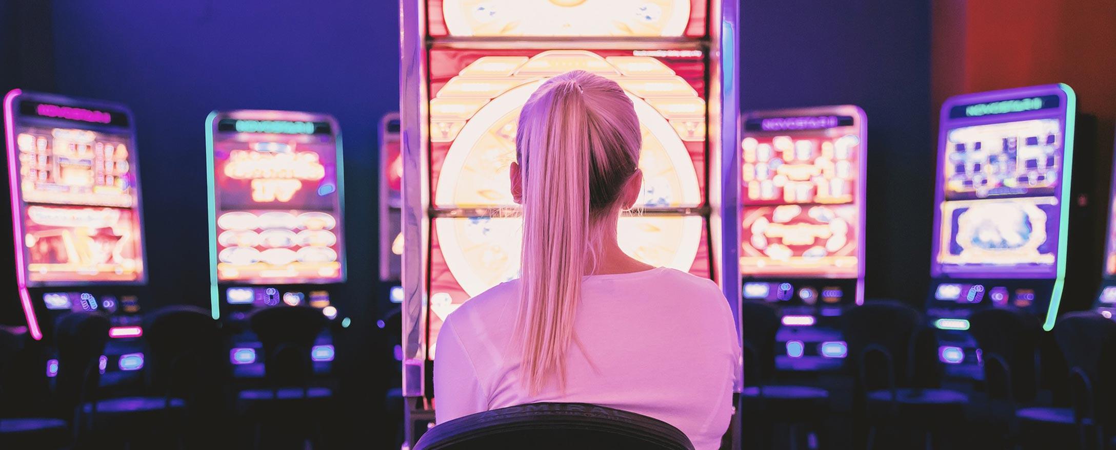 Gambler sitting at slot machine