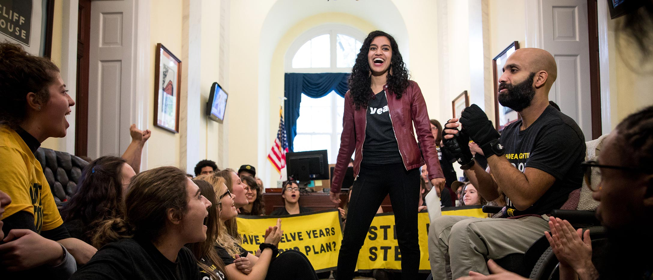 Varshini Prakash '15 speaks to demonstrators at a Sunrise Movement sit-in at the offices of the Speaker of the House.