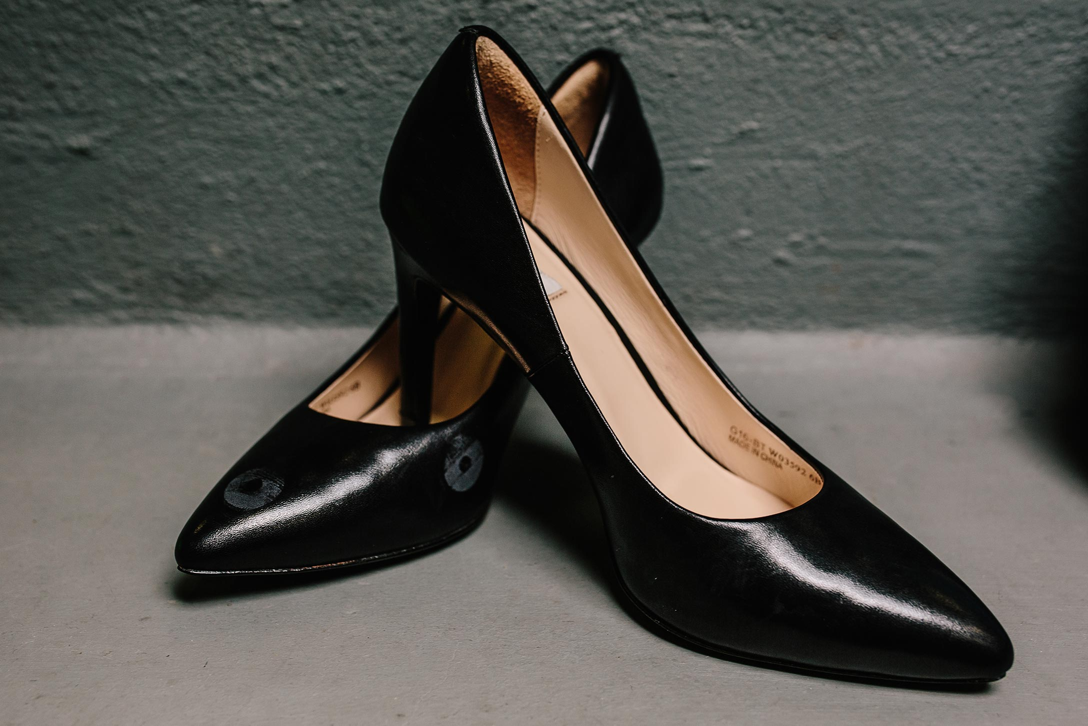 a pair of black leather high heeled shoes from the Cole Haan Grand Ambition collection