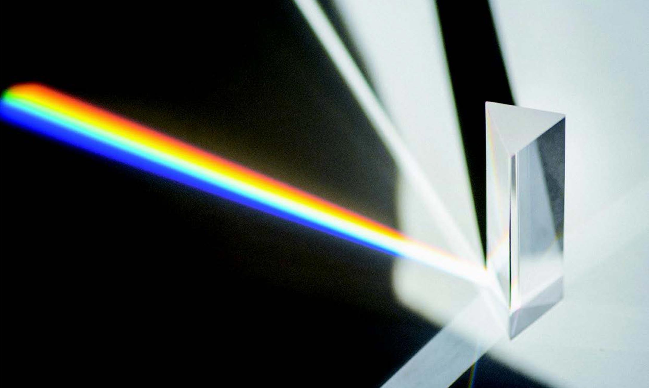 Prism splitting light into spectrum
