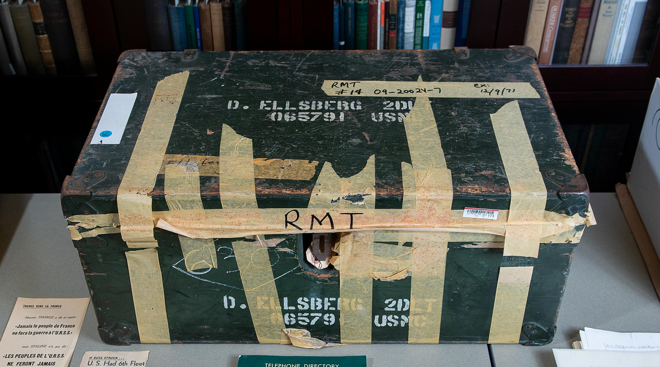 A dark green metal trunk crisscrossed with multiple strips of masking tape, one of the items in the Ellsberg archive