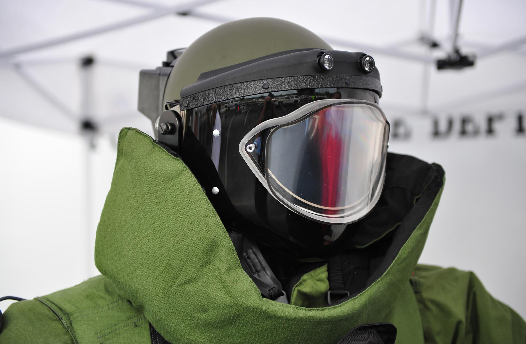 Person in military helmet, goggles, and jacket.