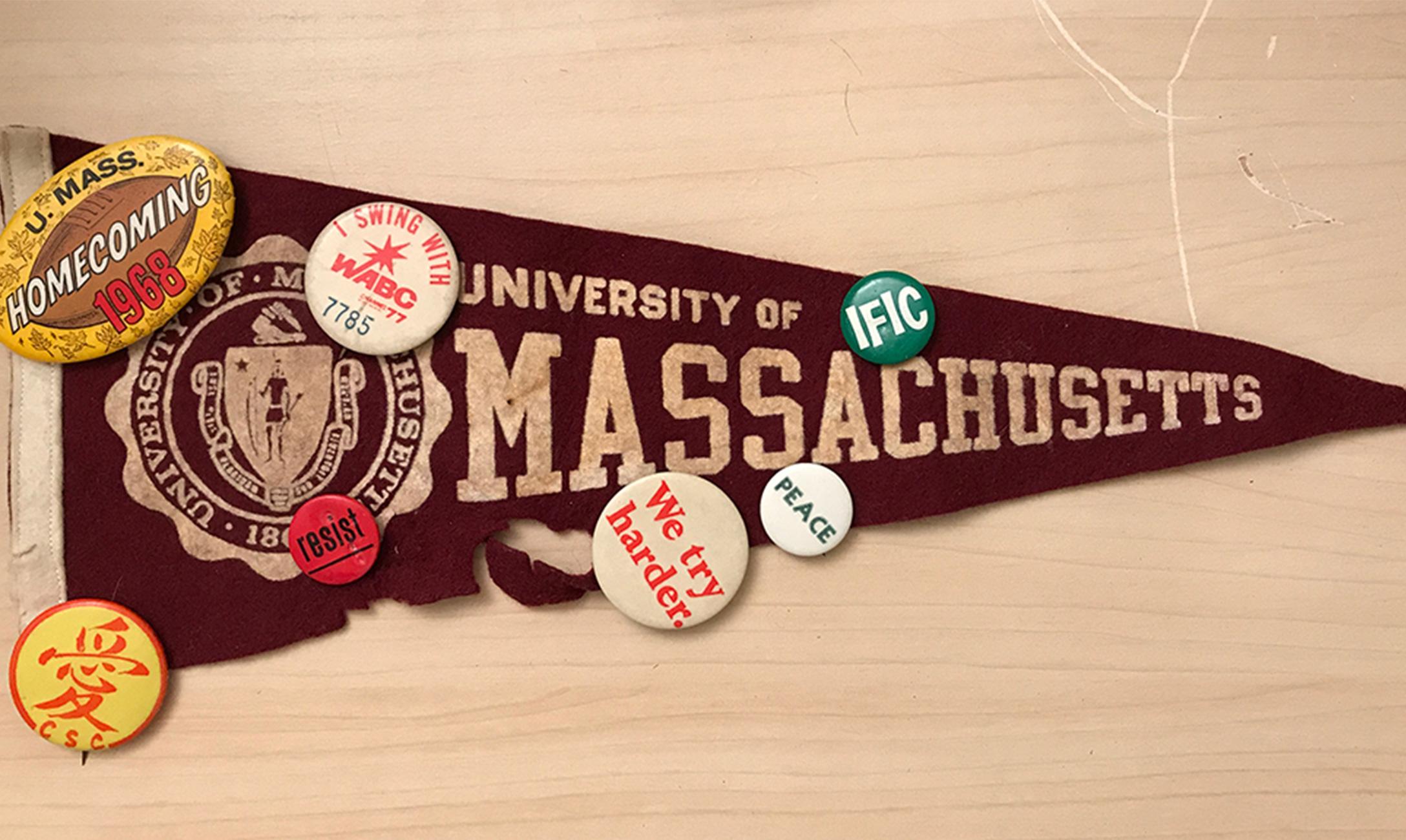 UMass flag studded with pins.