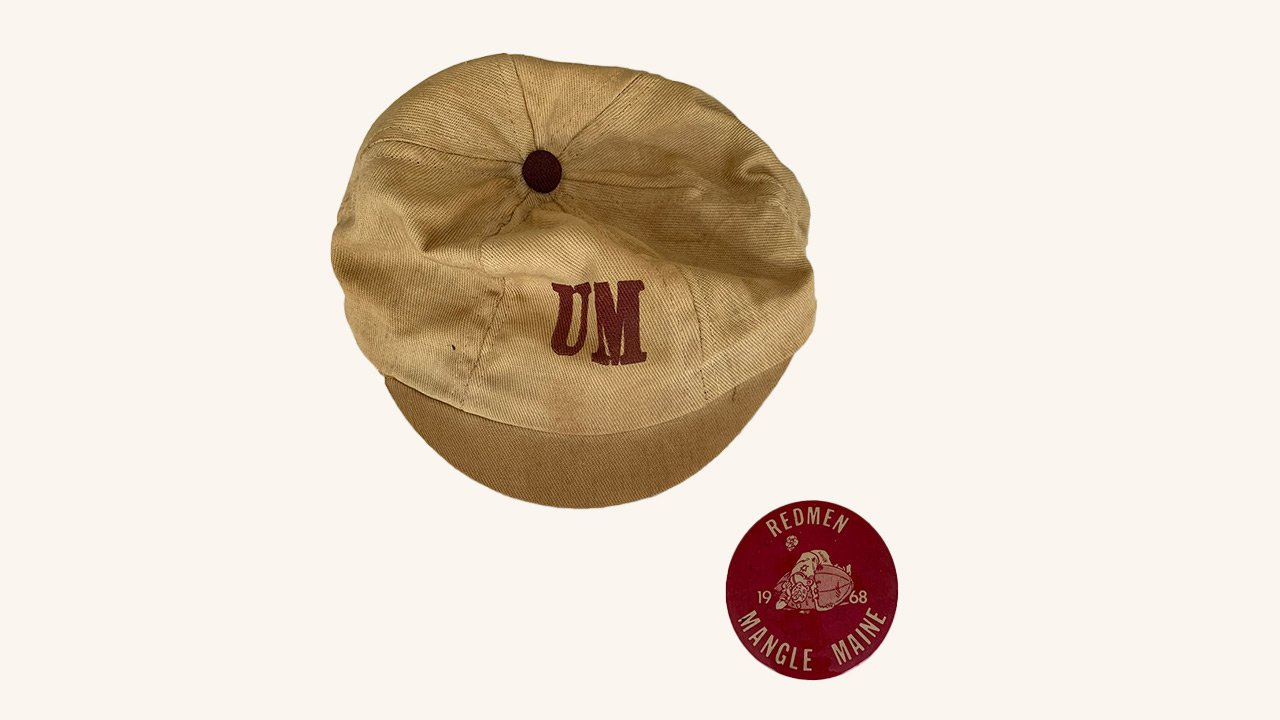 UMass branded cap and pin.