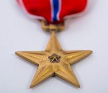 UMass alum John J. Fitzgerald '63, '78G medal.