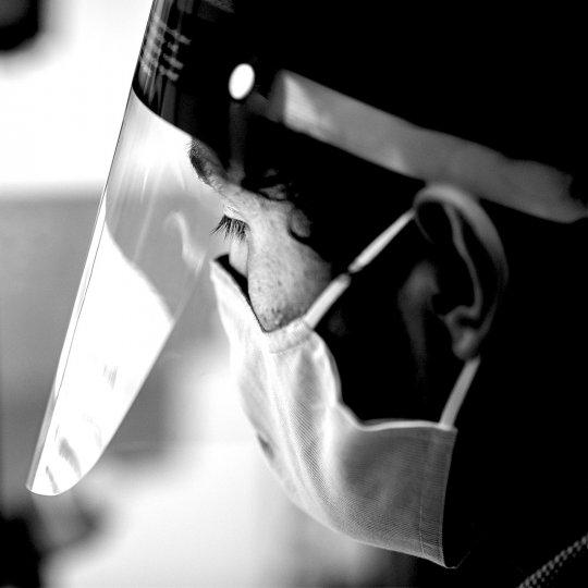 Researcher wearing face shield.