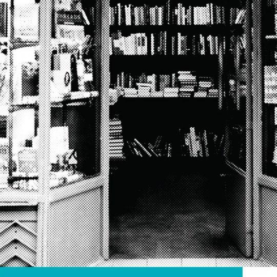 Storefront and open door of bookstore.