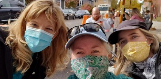 Three masked women outside