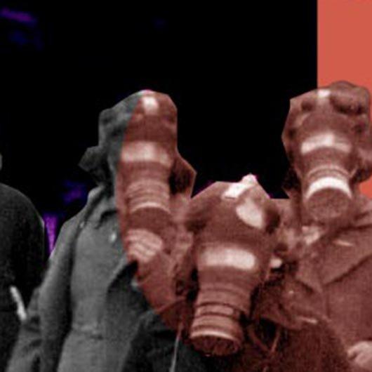 A group of schoolchildren wearing gas masks