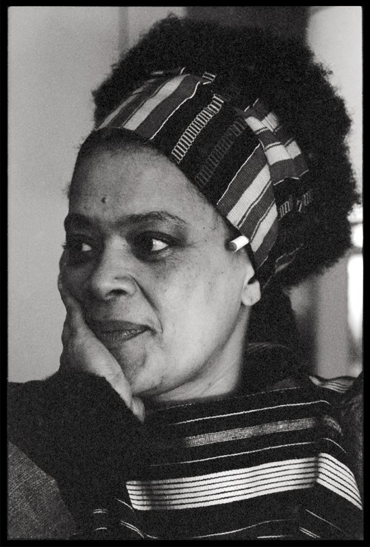 Black and white photo of black woman smiling.