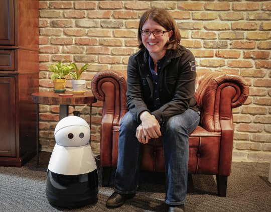 Sarah Osentoski and and her robotKuri.