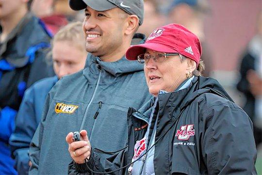 Coach Julie LaFreniere watching her team compete.