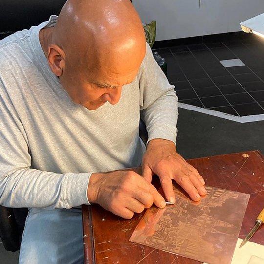 Tomolillo at work etching in metal.