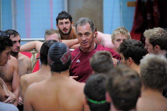 Coach Yarworth talking with swim team.