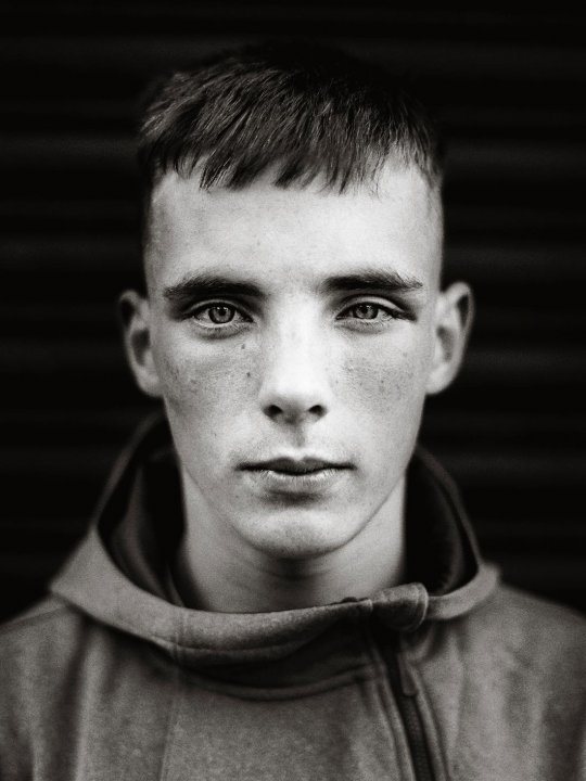 Black and white close up portrait of a boy in Northern Ireland