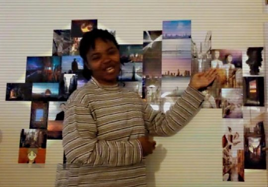 Young woman showing photo collage.