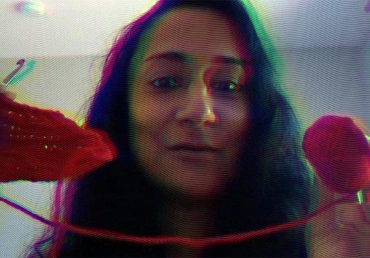 Woman holding yarn.