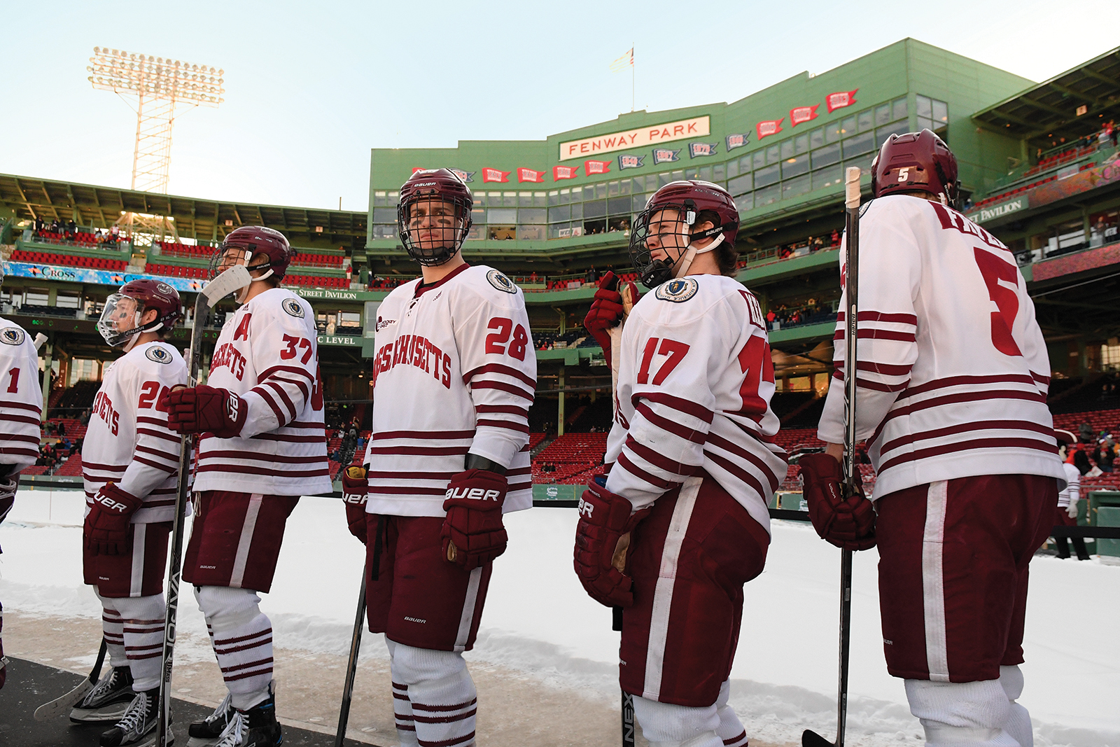 The UMass Amherst ice hockey team lines up at Fenway Park in Boston.