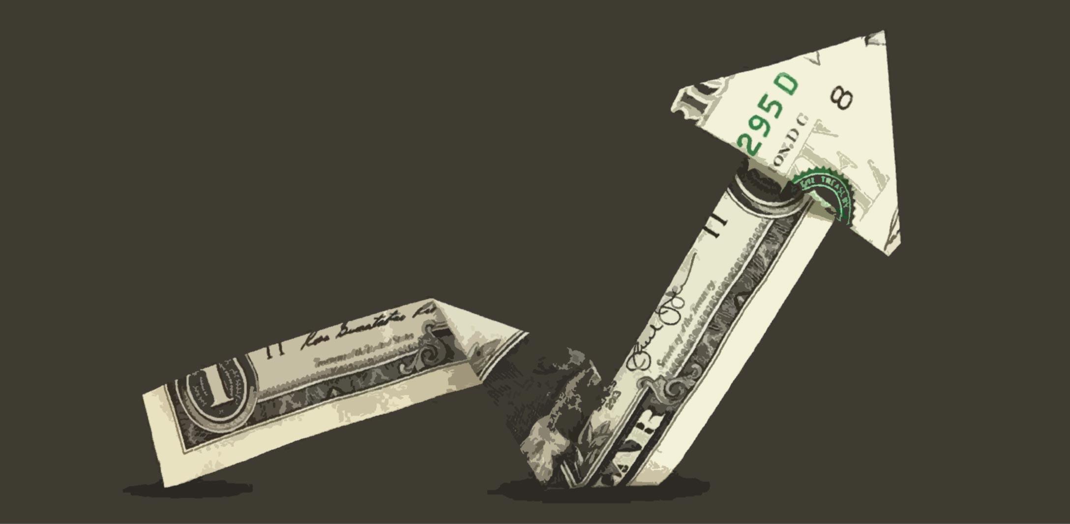 An arrow made from a folded dollar bill points upward.