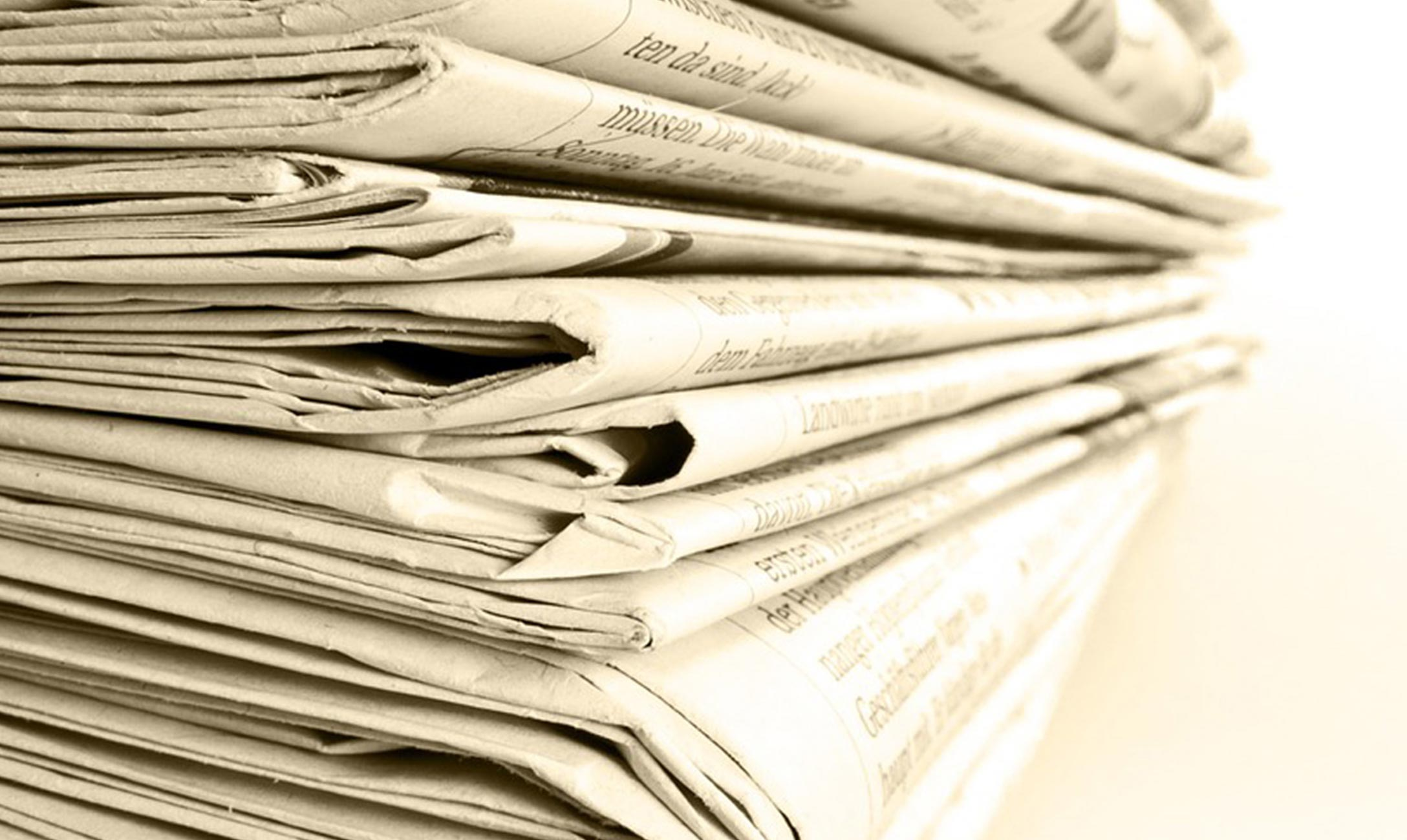 Stock photo of newspaper stack.