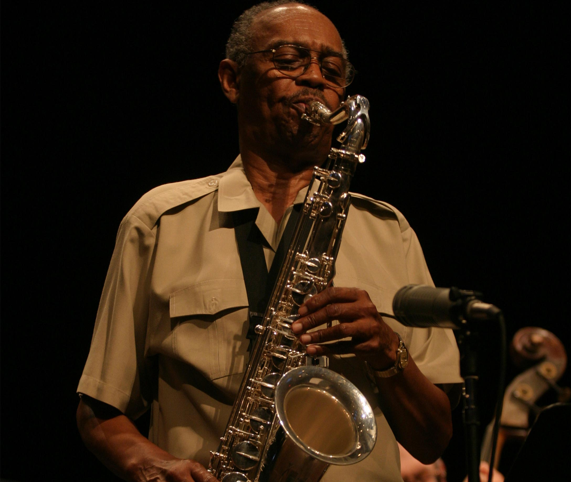 Tillis on stage playing the sax.