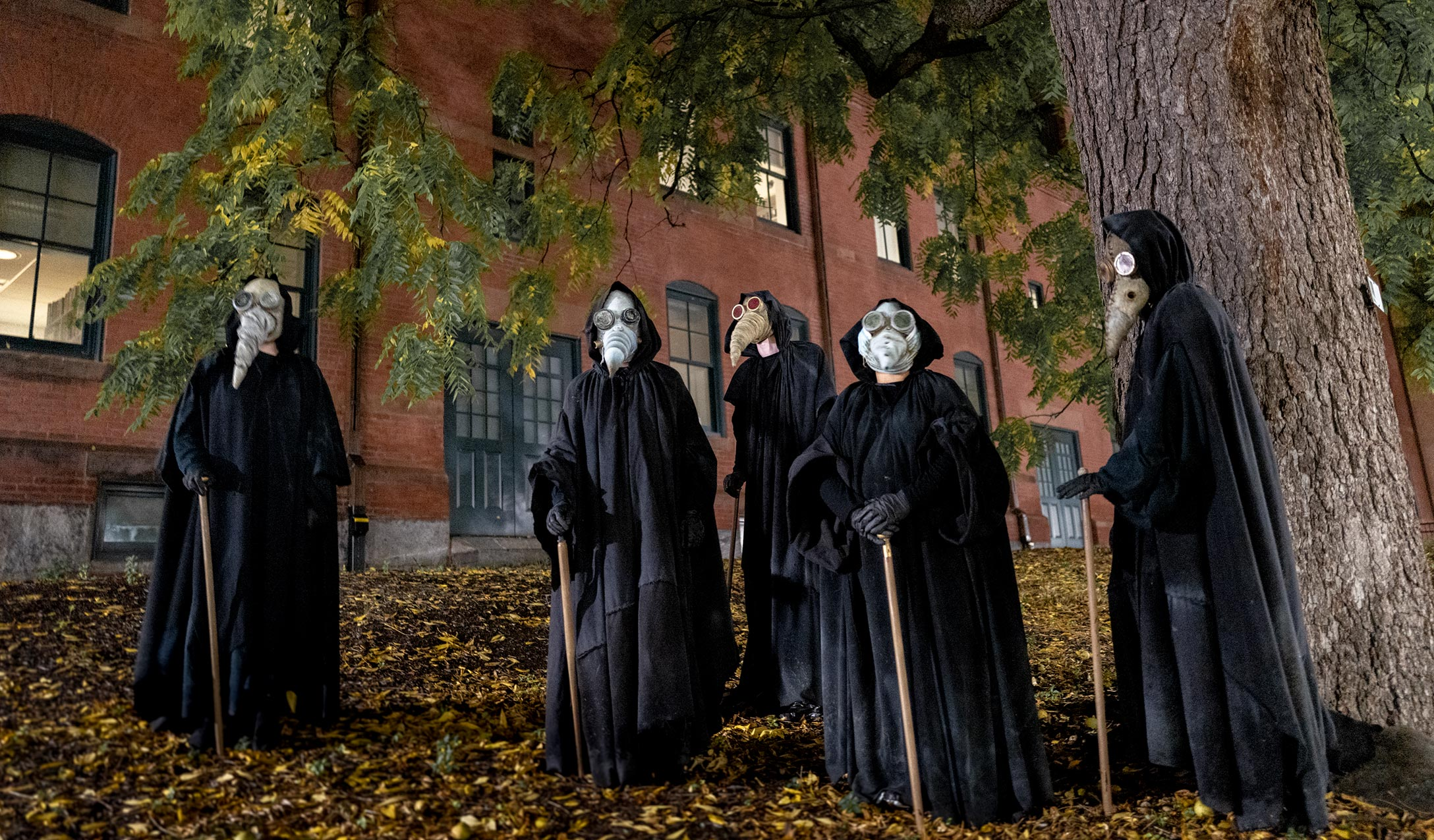UMass theater actors in plague doctor costumes