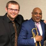 UMass trumpet student Matt Naeger and conductor Terell Stafford