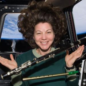 Astronaut Cady Coleman with weightless flute