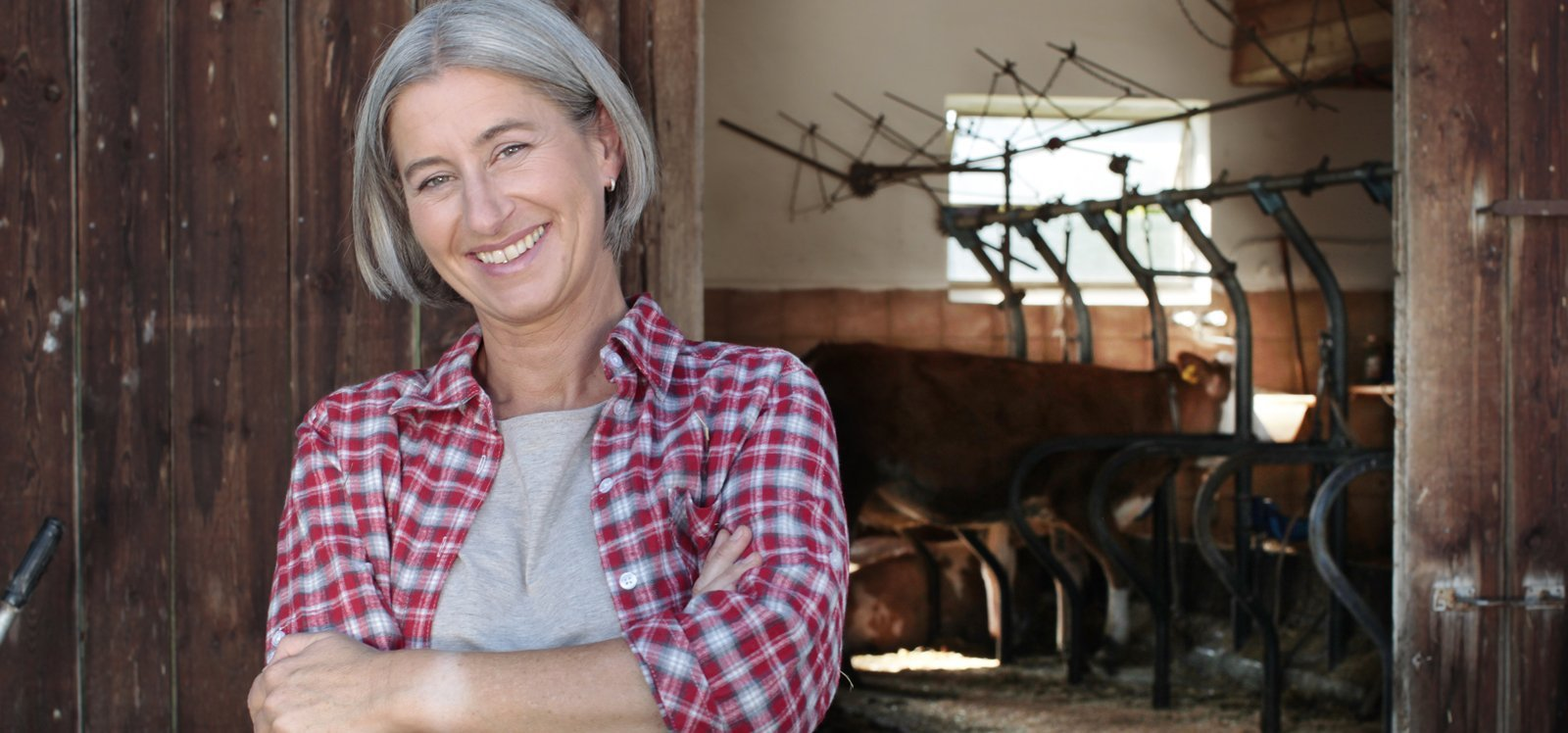 Middle-aged woman standing outside barn