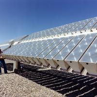 Checking the power output of a photovoltaic concentrator array built by Martin Marietta, Inc., at Sandia National Laboratory in Albuquerque, New Mexico. USDOE/Flickr