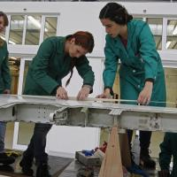 Students work on a plane's wing in an aeronautics class in Setúbal, Portugal