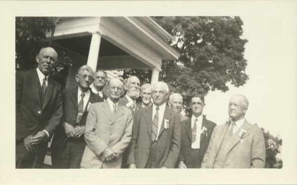 Members of the class of 1888 pose in front of the home of Mr. and Mrs. Field at a reunion in June, 1938. Jonathan E. Holt is on the bald man on the left in a dark suit, and Herbert Loomis has a short beard and is in the back row, June 1938