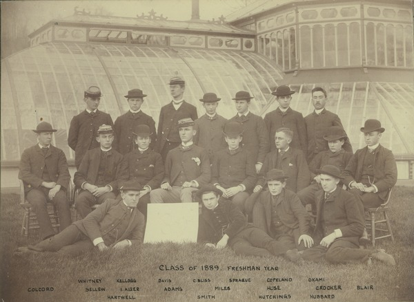 Class photo of 1889 taken in front of Durfee Plant House during freshman year, 1885