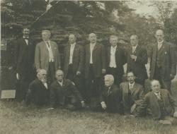 Twelve men from the class of 1876 under class tree, ca. 1926