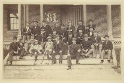 Class of 1881 sitting on the front steps of North College, 1878