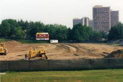 Garber Field astroturf installation project. The Southwest Dormitory Complex can be seen in the background, June 1997
